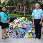 Representatives from HEMIC, including CEO Marty Welch, donate nearly 2,000 slippers to Helping Hands Hawaii.